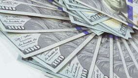 Many 100 US dollars bank notes rotating background stock footage