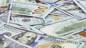 Many 100 US dollars bank notes rotating business background. Loop ready stock video footage