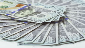 Many 100 US dollars bank notes rotating business background. Loop ready stock video