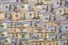 Many us dollars pile as background. Close up Royalty Free Stock Image