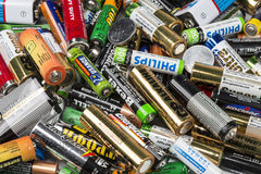 Many used AA and AAA sized batteries Stock Image