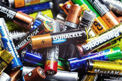 Many used Colorful AA and AAA. KYIV, UKRAINE - March 03, 2016: Many used Colorful AA and AAA sized batteries in a pile at black background. Concept background of royalty free stock photos
