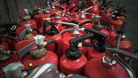 Many used fire extinguishers as background Stock Image