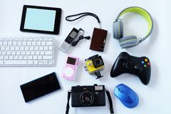 Free Many Used Modern Electronic Gadgets For Daily Use On White Floor, Reuse And Recycle Concept Stock Image - 164230611