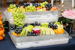 Many useful fruits of grapes, apples, grapes, oranges. The conce. Pt is healthy food, party, buffet, catering Royalty Free Stock Photography