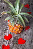 Many Valentine hearts with ananas on the old wooden table Stock Photography