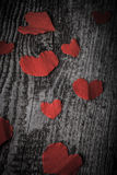 Many Valentine hearts on the old wooden table. Toned Royalty Free Stock Photography