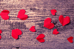 Many Valentine hearts on the old wooden table. Toned Royalty Free Stock Photos
