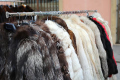 Many valuable fur coat in vintage style for sale Royalty Free Stock Photo