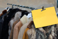 Many valuable fur coat in vintage style for sale Stock Photo