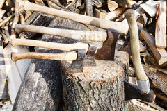 Many various axes in wooden block Royalty Free Stock Image