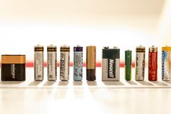 Many various batteries and accumulators, Hemer, Germany - 20 May 2017. Many various batteries and accumulators are lined up. Some of them are old Royalty Free Stock Image