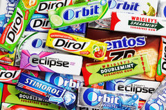 Many various colorful chewing or bubble gums. TULA, RUSSIA - APRIL 28, 2014: Many various colorful chewing or bubble gum including Orbit, Dirol, Eclipse Stock Photos