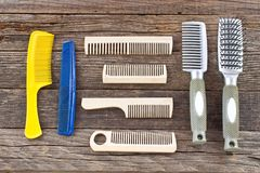 Many various combs on wooden background Royalty Free Stock Photo