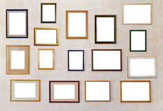 Many various photo frames  hang on a wall. Stock Images