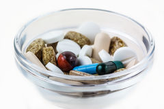Many various pills in glass bowl Stock Image