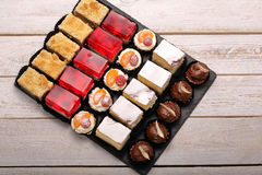 Many various types of cakes in catering set with space for text Royalty Free Stock Image