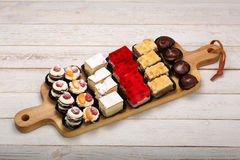 Many various types of cakes in catering set with space for text Stock Image