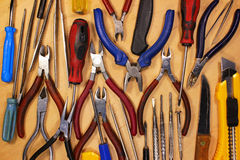 Many various vintage screwdrivers pliers tweezers and knives. Ol Royalty Free Stock Photo