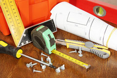 Many various working tools on a wooden table Stock Images