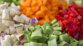Many vegetables cut on dices on a plate Stock Image