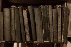 Many vintage books on a shelf Royalty Free Stock Photo