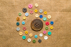 Many  vintage  buttons  on the old cloth Royalty Free Stock Photos