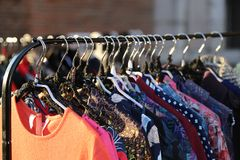 Many vintage style clothes  for sale at flea market Royalty Free Stock Image