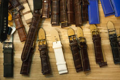 Many vintage watch straps on wood table for repair royalty free stock photo