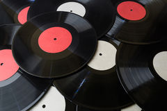 Many vinyl discs red and white label Royalty Free Stock Image