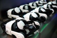 Many virtual reality VR helmet on dark background Stock Photo