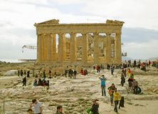 Many of Visitors at the Parthenon, the Ancient Greek Temple Dedicated to Goddess Athena, Hilltop of Acropolis of Athens, Greece. Europe antique archaeology royalty free stock image
