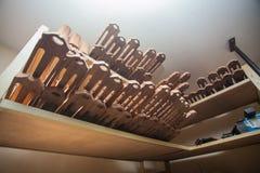 Many vultures for guitars lie on shelf at workshop Stock Images