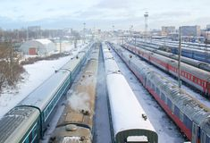 Many wagons under snow on cargo terminal Royalty Free Stock Photos