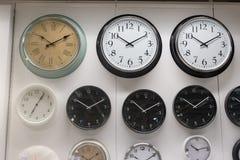 Many wall clock on the wall Stock Image