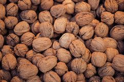 Many walnuts for sale. Walnuts texture and background. Healthy organic food concept. View above Royalty Free Stock Images