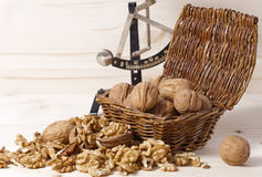 Many walnuts shelled and in-shell macro in a wicker basket Royalty Free Stock Images