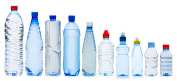Many water bottles. On white Royalty Free Stock Photos