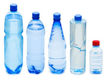 Many water bottles. On white Stock Photography