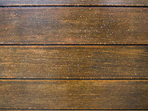 Many water drops on wooden surface Stock Image