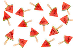 Many watermelon slice popsicles isolated on white, fresh summer fruit concept royalty free stock images
