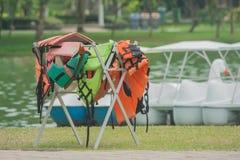 Many wet life jacket hanging on clothes line. Stock Image