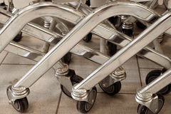 Many wheels of mall push carts closeup shot. Vintage color-look Royalty Free Stock Photos