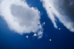 Many white balloons in the blue sky. Celebration concept against the blue sky and clouds. royalty free stock photography