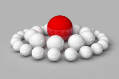 Many white balls among which the red stands out Royalty Free Stock Image