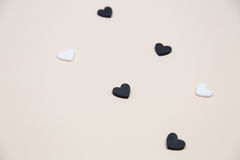 Many white and black hearts Stock Images