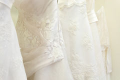 Wedding dress. Many white bride dresses on shop Royalty Free Stock Photography