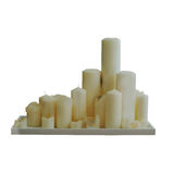 Many white candles Stock Photo