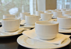 Many  white coffee cups  waiting for  serving Royalty Free Stock Images