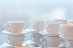 Many white coffee mugs Stock Photography